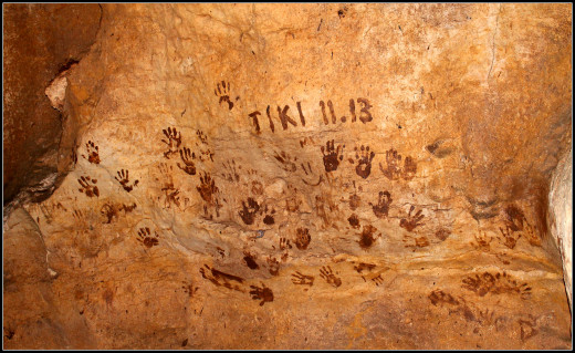 Handprints of the archaeologists that discovered the cave system and thermal springs on the Rio Dulce.