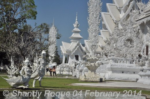 Eternal lovers by the pond.  Location: Wat Rong Khun (The White Temple)