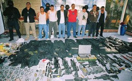 Captured gang members and their weapons