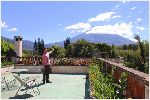 Andy on the rooftop terrace pointing at Volcan Agua