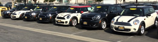 Various models of the MINI available on the lot of a dealership.