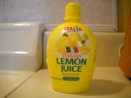 You can use either actual lemon juice or this kind. Either will work.