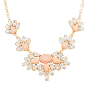 Lush pairing of pink, silver, and gold tones, shimmering together in the Aurelia necklace. Oval, marquis, and teardrop stones combine for a stunning floral display.