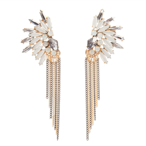 Translucent marquee crystals fan out to form Nicolette's dramatic design, complemented by contrasting chain tassels. These evening- ready stunners will wow at your next occasion