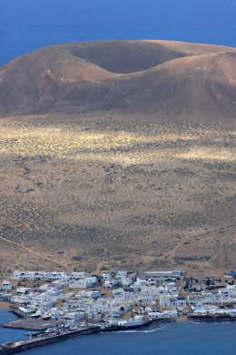 Volcanic crater and the town of Caleta de Sebo - principal settlement on La Graciosa
