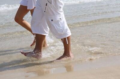 Walking on a beach is fun.