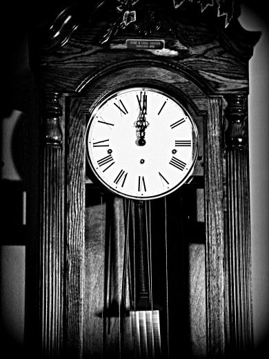 As the grandfather clock in the hallway chimed twelve . . .