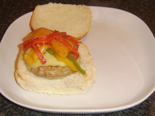 Fried peppers top spicy pork cheeseburger