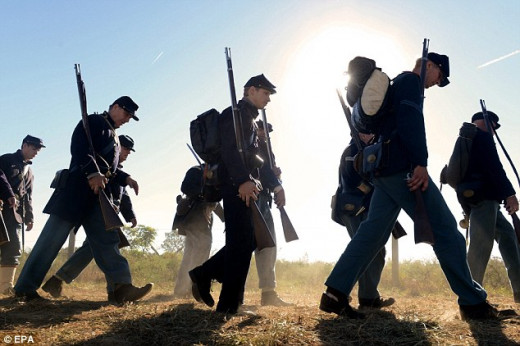 Living Historians march to the battlefield
