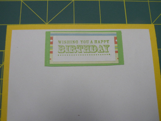 Adhere completed phrase layers to card