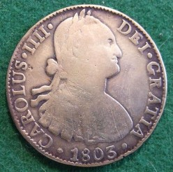 A Spanish silver dollar, also known as a piece of eight because it divides into 8 reales.