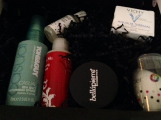 The February 2014 Glossybox case with a full-sized sea salt hair spray, moisturizing cream, a loose powder blush, a popular make-up applicator (Beauty Blender), and a toning body wash.  Love the products!