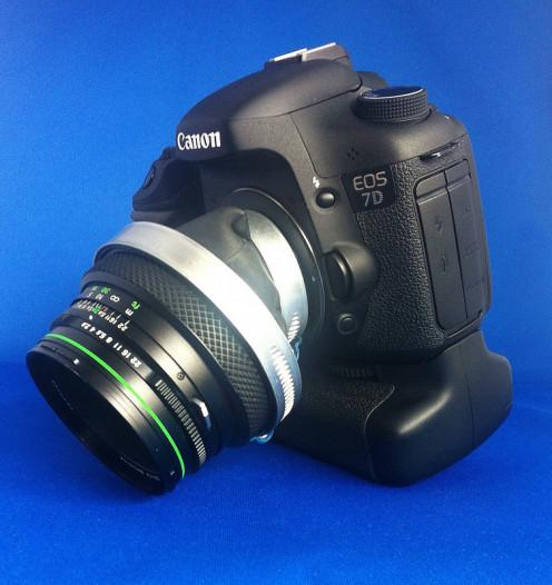 A tilt-shift lens attached to a Canon 7D.