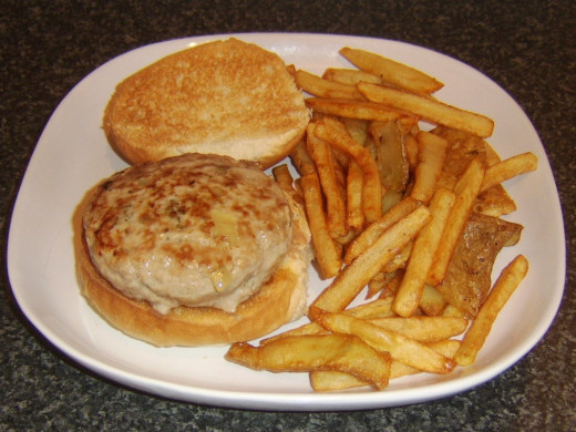 Pork, sage and onion burger with fries and skins