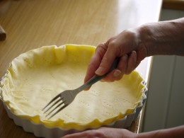 You can use a fork to work dough into fluted pie pan.