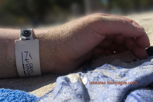 Relaxing on beach with my resort bracelet which identifies me as a current guest.