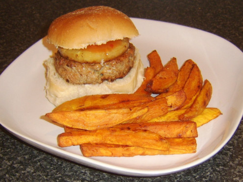 Sweet and sour sauce seasoned pork burger with pineapple and sweet potato fries