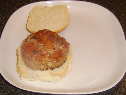 Sweet and sour pork burger is added to bread roll