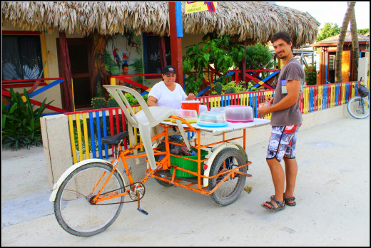 Andy buying lime and coconut pie from Caye Caulker's pie cart lady