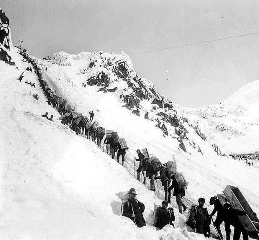 Prospectors ascending the Chilkoot Pass