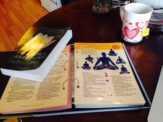 How my table looks when I'm planning a class. The Yoga Toolbox and The Book of Awakening. (And a cup of tea, of course.)
