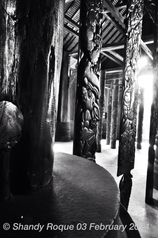 Intricately carved pillars of ghouls and demons line the interior of The Black House.