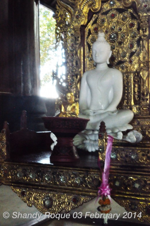 In another section of Baan Dam's main house is a peaceful white Buddha on a golden throne as if a reminder that there is a piece of heaven awaiting in the midst of hell.