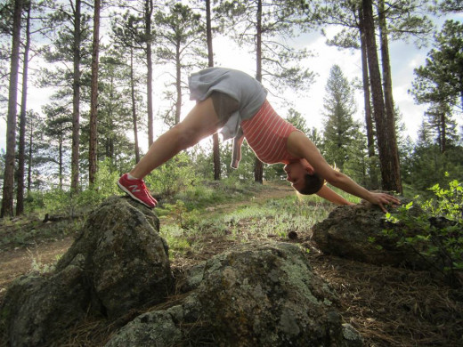 Be playful! Here I am enjoying a downward dog in the trails of Colorado.