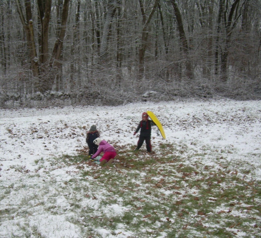 Children playing after a dusting of snow in late fall/early winter