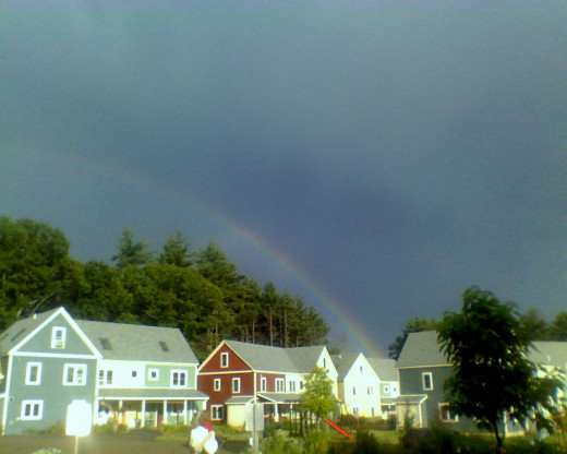 Summer rains bring rainbows of hope ~ a double rainbow over our co-housing village.
