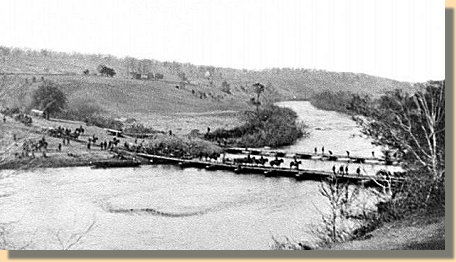 Cavalry crosses a pontoon bridge over the Rapidan River in Virginia