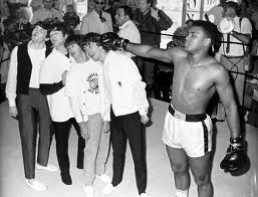 The Beatles take a straight right from the wonderful Muhammad Ali ( Cassius Clay ).