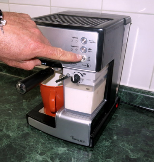Fill the reservoir with cold milk, slide a warmed coffee mug into place and push the button.