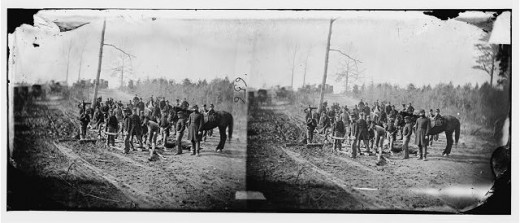 Stereo photograph that shows engineers in the act to corduroy a road