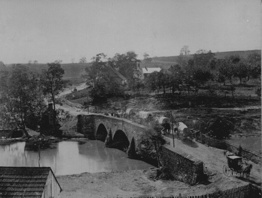 Supply wagons pass over Antietam Creek via a stone bridge