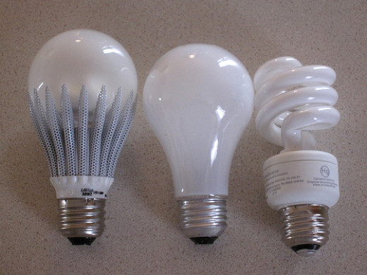 An LED light (designed to look similar to) a regular incandecent bulb and a CFL spiral bulb