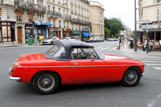 A bright red MG sports car in Paris, France.