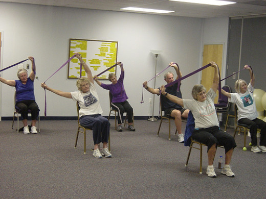 Pilates bands being used in a class. The bands can be used regardless of fitness level and age. The results are effective.