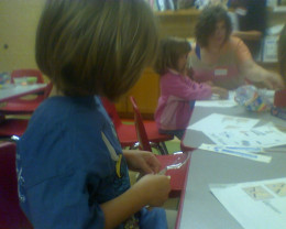 My daughter making a craft at the library