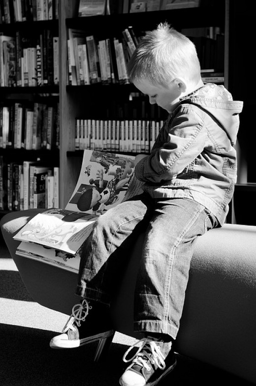 A boy reading a book.