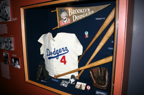 """Baseball pennant of the Brooklyn Dodgers - """"Dem Bums"""", shown by the clown tramp."""