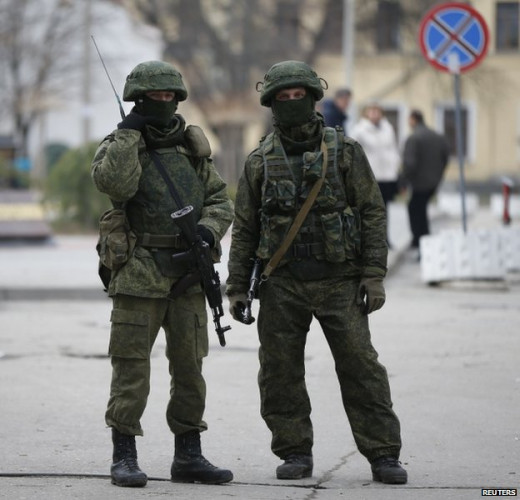 Unmarked soldiers believed to be Russian troops occupy the areas around military bases in Crimea.
