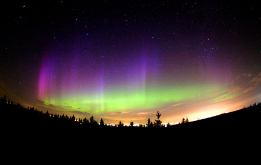 A colorful auroral display. The purple color is caused by nitrogen gasses.