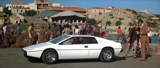Roger Moore as James Bond admiring the Lotus Esprit S1.