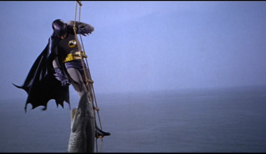Batman repels a shark with his shark repellent spray