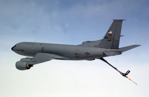 An KC-135 aerial refueling aircraft with its boom extended.