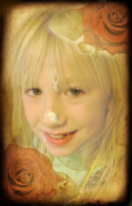 Child with Blond Hair.and Frosting on Face
