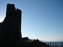 The ruin of Aberystwyth Castle silhouetted against the sky