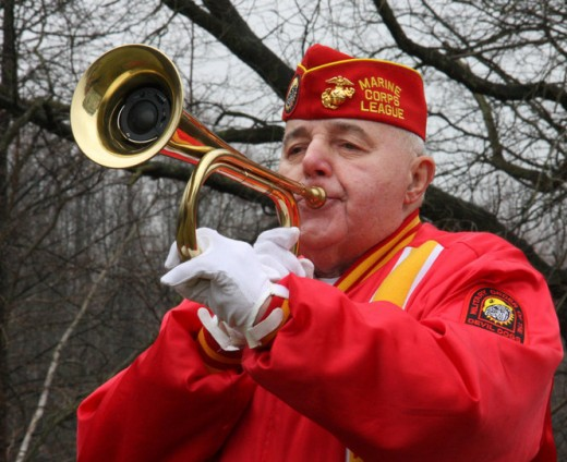 Vincent Endron plays Taps to honor Sgt. Mendez on the anniversary of his death, 16 March 2012.