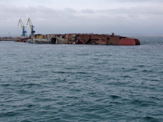 A scuttled Russian ship is turned on its side near Black Sea ports in an effort to blockade Ukrainian ships.